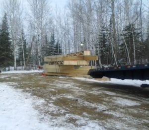 Roof truss deliver for custom lake home huisman concepts ely mn