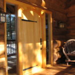 Alaskan Yellow Ceda plank door in log home