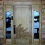 Wildflowers hand carved on curly maple door